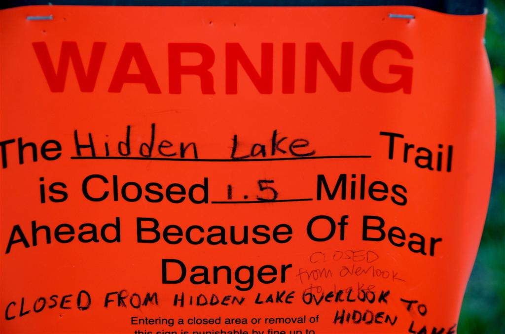 August 23<br /> <br /> The trail beyond the overlook is closed due to bear activity. That typically means one has been sighted there recently. The signs will be taken down when Rangers verify there is not current bear sightings.<br /> <br /> A hiker had been missing in the Hidden Lake area for over 30 days.  He is 19 years old and works for the park part time. His picture is posted all over the park. It is a bad situation. <br /> <br />  September 13<br /> I search the Glacier news about the missing hiker and find the following:<br /> <br /> Missing Hiker Located<br /> Date: September 13, 2012 <br /> Contact: Denise Germann, 406-888-5838 <br /> Glacier National Park Rangers have recovered the body of missing hiker Jakson Kreiser. At approximately 12:30pm today, hikers notified park personnel that they found evidence believed to be related to the search for Kreiser. The hikers found human remains in an area southwest of Hidden Lake. Park rangers and a Flathead County Coroner traveled to the site and the coroner confirmed that the deceased body was Kreiser. The body was recovered and an autopsy will be performed to determine cause of death.<br /> <br /> A search for Kreiser began July 29 after he was reported missing when he failed to return following a hike on July 28. Glacier National Park employees, with assistance from North Valley Search and Rescue, Flathead Search and Rescue, Can Am Search and Rescue, Flathead County Sheriff's Office, Lake County Sheriff's Office, and the US Border Patrol, conducted an extensive ground and aerial search for eight days before scaling back efforts.  <br /> <br /> The search area was focused between Hidden Lake and Avalanche Lake, and in the Floral Park area.  This area includes some treacherous country filled with rock cliffs, water falls, wet and slippery rocks and boulders, and dense vegetation.<br /> <br /> Kreiser, age 19, was from Michigan and a seasonal employee with Glacier Park, Inc. at Lake McDonald Lodge. This was his first year working in the area.
