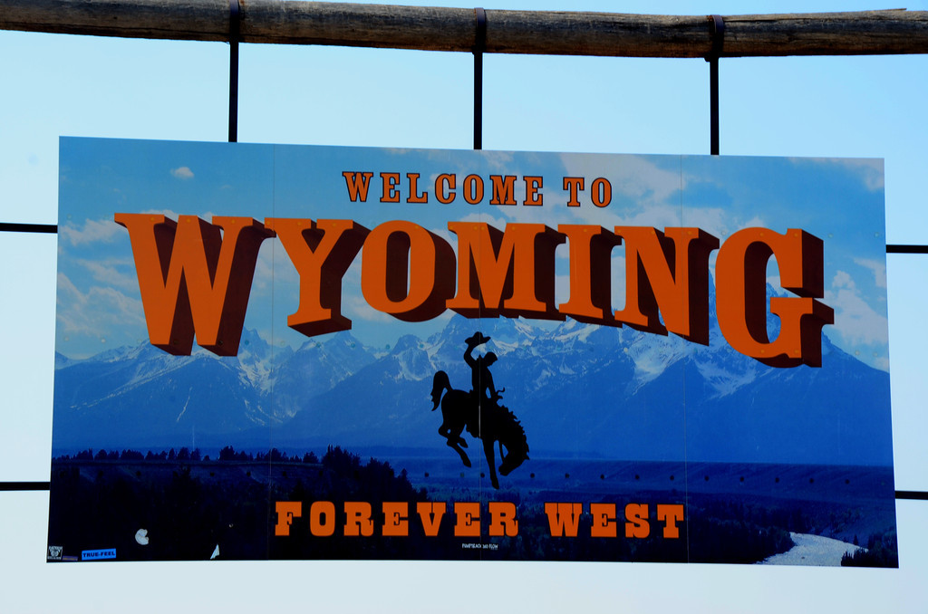August 17<br /> <br /> I am welcomed to Wyoming. Without the family,  I can't do the Clark Griswald photo in front of the sign.