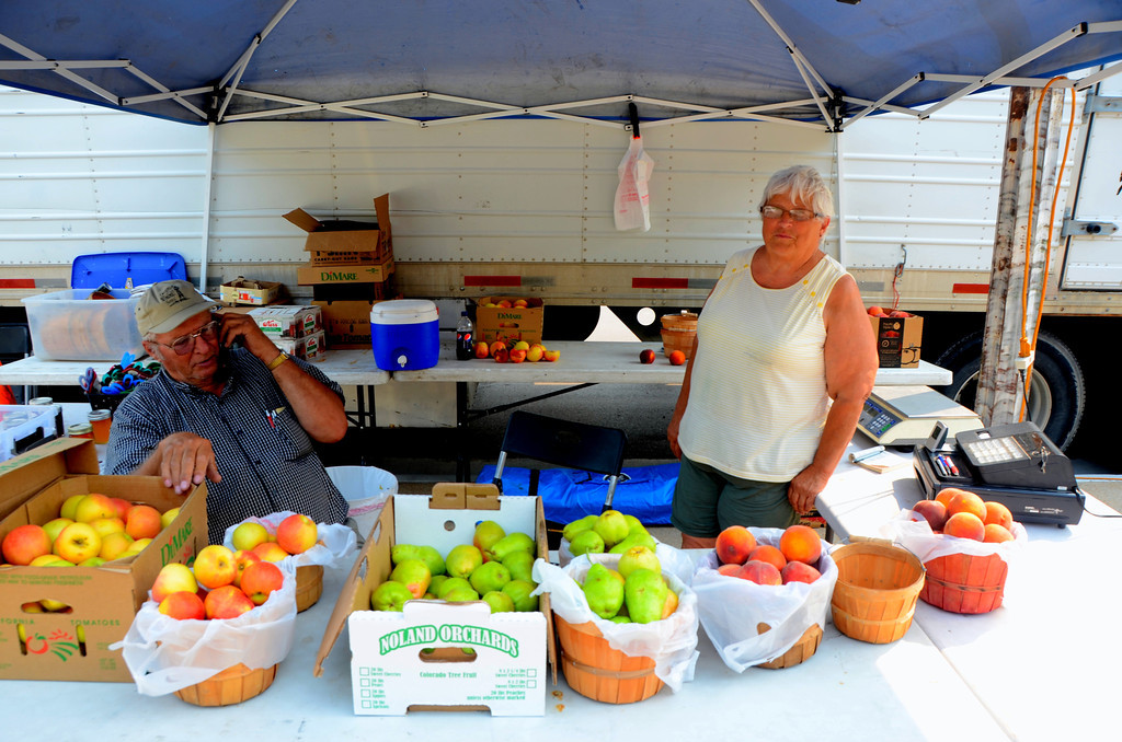 "August 15<br /> <br /> I stopped at the courthouse because this couple had setup their fruit stand in the front of the courthouse as they have done for 19 years. I purchase a basket of Colorado peaches that have ripened on the tree. You can't beat a properly ripened peach. By some sort of coincidence the small dog they travel with is named ""Peaches""."