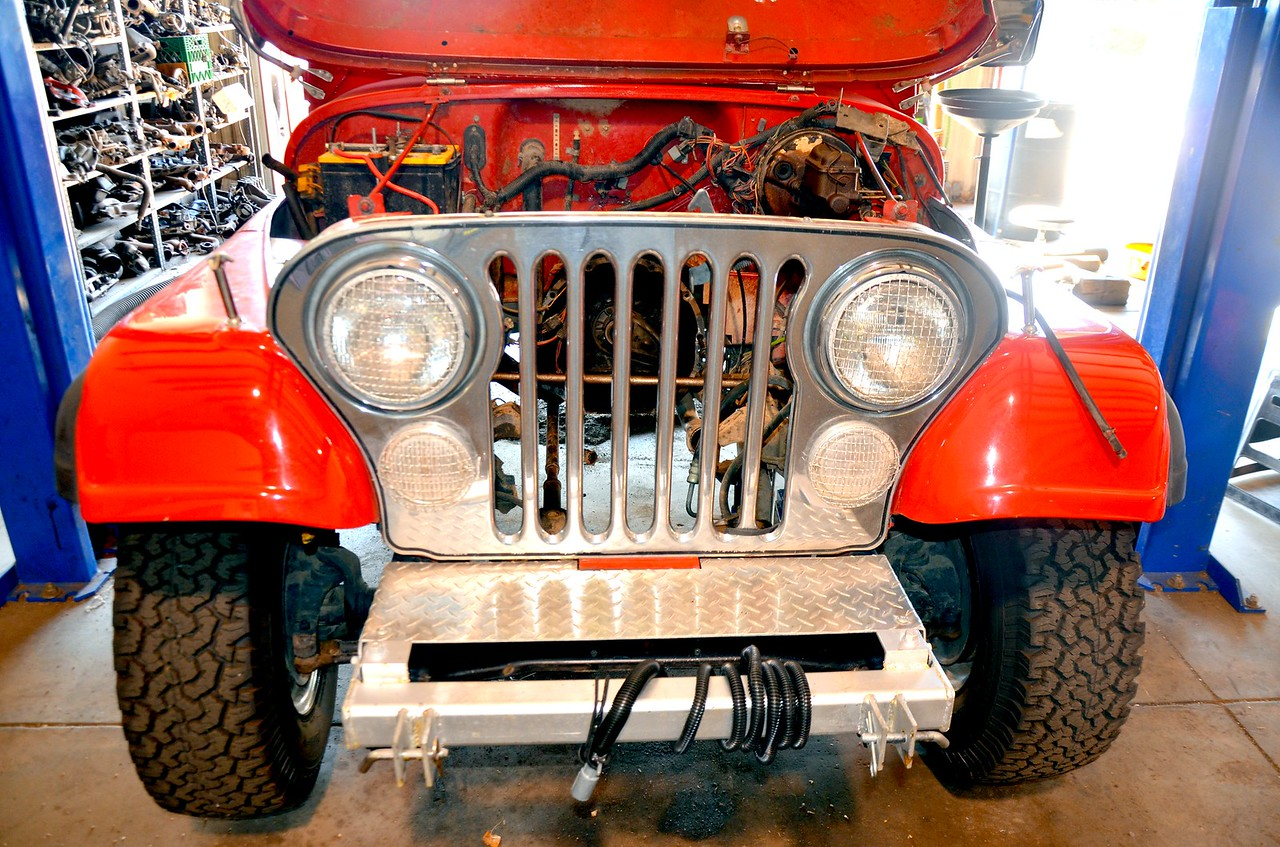 Front view showing front bumper modification  for towing and<br />  lighting added prior to return home trip.