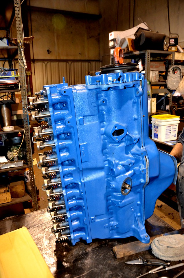 Partially assembled  remanufactured engine in AMC blue.  Waiting on new high energy distributor and  aluminum alloy valve cover to replace the stock  plastic one.