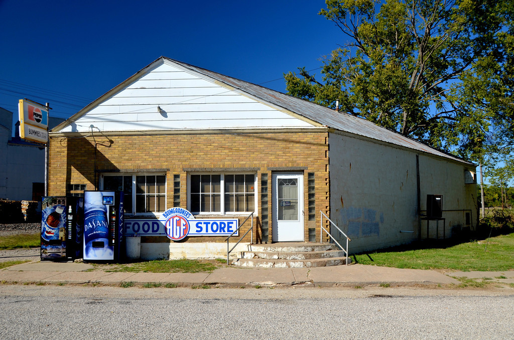 "Not much left in Elmdale, Kansas. <br /> <br /> Almost a ghost town now, Bummies grocery is the only business still open. Maria Bumgartner is 95 years old and still runs the store.  She and her husband opened the store in 1947. Her husband Glen, who everyone called Bummie, has been gone about 15 years now,.<br /> <br /> Maria is originally from the nearby town of Clements. In 1938, she married Glenn Baumgardner who from an early age was nicknamed Bummie. Maria came to be known as Ms. Bummie.<br /> <br /> Maria was profiled by Larry Hatteberg at the attached link. <br />  <a href=""http://www.kake.com/hattebergpeople/headlines/Hattebergs_People_-__112788169.html"">http://www.kake.com/hattebergpeople/headlines/Hattebergs_People_-__112788169.html</a>"