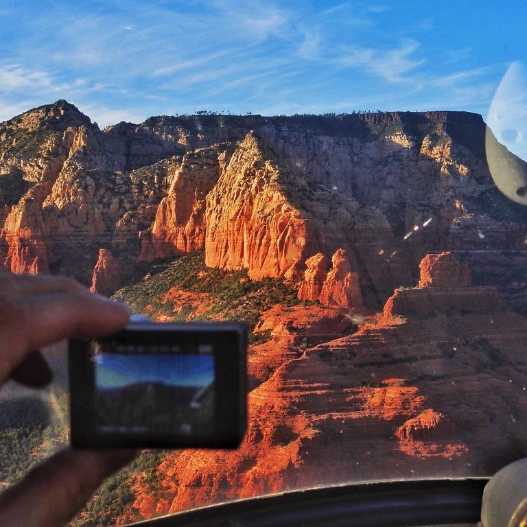 Sedona sunset helicopter flight. Taking stills and video at the same time. Multitasking photography.