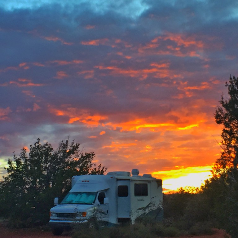 """Desert Sunset Delight at Camp Grumpella.<br /> """"Soon it got dusk, a grapy dusk, a purple dusk over tangerine groves and long melon fields; the sun the color of pressed grapes, slashed with burgandy red, the fields the color of love and Spanish mysteries.""""<br /> Jack Kerouac, On the Road"""