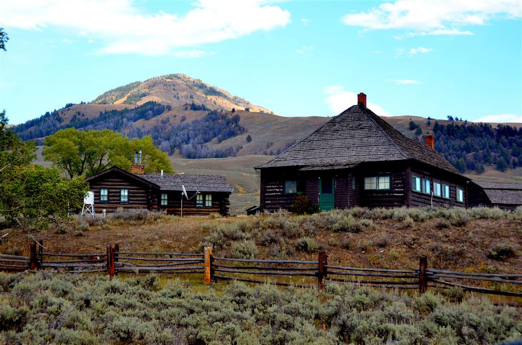 "September 9<br /> <br /> <br /> The Buffalo Ranch<br /> <br /> ""The Lamar Buffalo Ranch was built in the early part of the century in an effort to increase the herd size of the few remaining bison in Yellowstone, preventing the feared extinction of the species. Buffalo ranching operations continued at Lamar until the 1950s. The valley was irrigated for hay pastures, and corrals and fencing were scattered throughout the area. Remnants of irrigation ditches, fencing, and water troughs can still be found. Four remaining buildings from the original ranch compound are contained within the Lamar Buffalo Ranch Historic District (two residences, the bunkhouse, and the barn) and are on the National Register of Historic Places."""