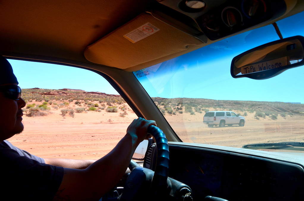 Navajo guides must escort you. We loaded up 5 surburbans and raced across sand in a dry wash towards the canyon.