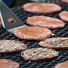 Kevin Burkett | Pharos-Tribune<br /> <br /> Pork burgers are prepared for serving at the Pork Producers Food Booth near the Exhibition Building on Wednesday, July 12, 2017.