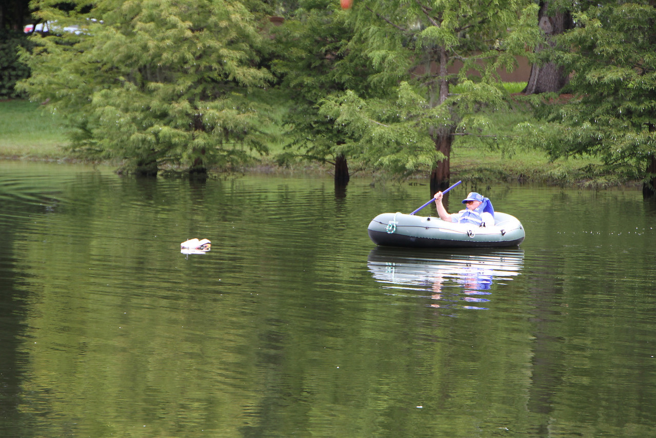 Gary's boat flipped and there were no remote control recovery boats avaliable, so he had to resort to a raft and human retrieval.
