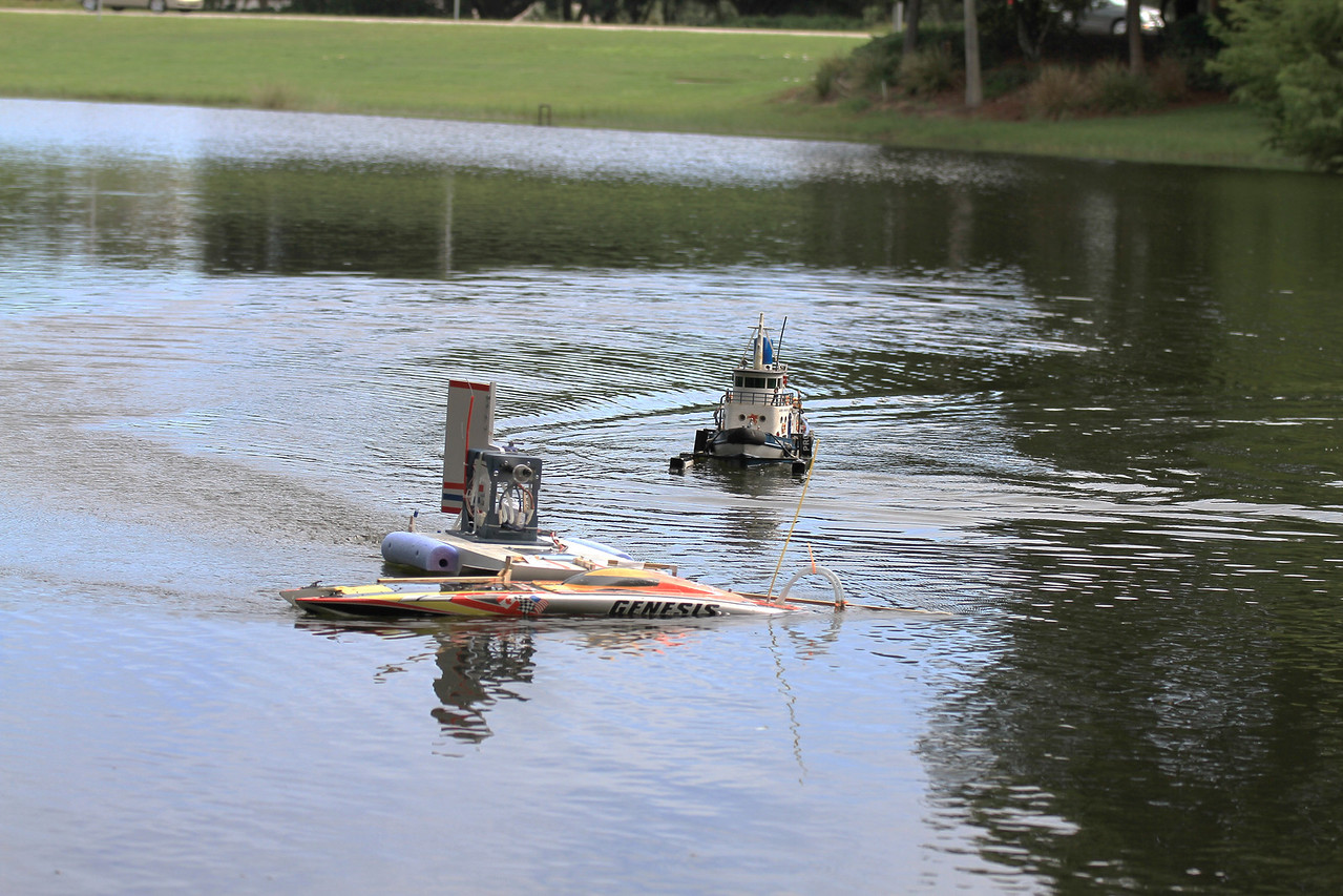 Practicing using an airboat to recover a disabled boat.  Tug as a back-up.