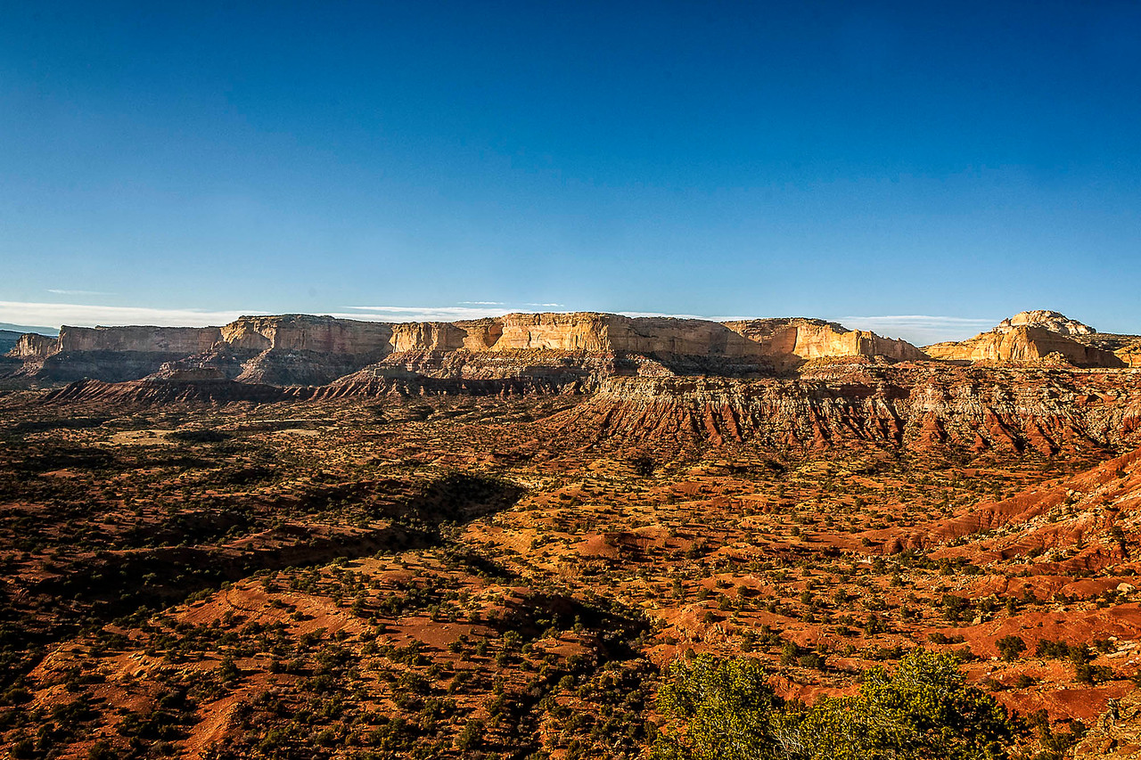"""Eons ago, tremendous geologic upheavals formed a giant dome of rock - a """"swell"""" in the earth's surface. The harsh elements beat against this dome and eroded it into a wild, broken array of multi-colored sandstone. Wind and water carved this jumble of rock into incredible formations as buttes, canyons, pinnacles and mesas emerged, making the Swell one of the most ruggedly beautiful pockets of terrain in the world. That was how this area came to be known as San Rafael Swell."""
