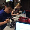 Serena and friend put together Lego Mindstorms during Teen Lounge