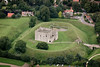 Aerial photography of Castle Rising near Kings Lynn in Norfolk.