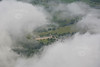 Chatsworth House through the clouds.