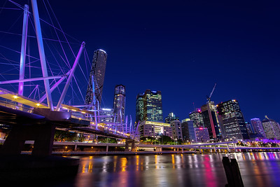 This is what a $63 million (AU) hybrid tensegritybridge looks like at night. It's official name is the Kurilpa Bridge, opened in 2009 and it connects Kurilpa Point inSouth Brisbane to Tank Street in the Brisbane CBD. I've included all this information to try and disguise the fact I can't explain what a tensegrity bridge is. I could have Googled it and included the definition (written in my own words), however there were two reasons why I didn't. One, I didn't want to sound condescending and assume other's didn't know what it might either. Two, I was more interested in finding out that the aboriginal word Kurilpa means 'place of water rats.'   John's Blog https://blog.caswellimages.com/  The latest print price guide: https://bit.ly/3oLw9OI