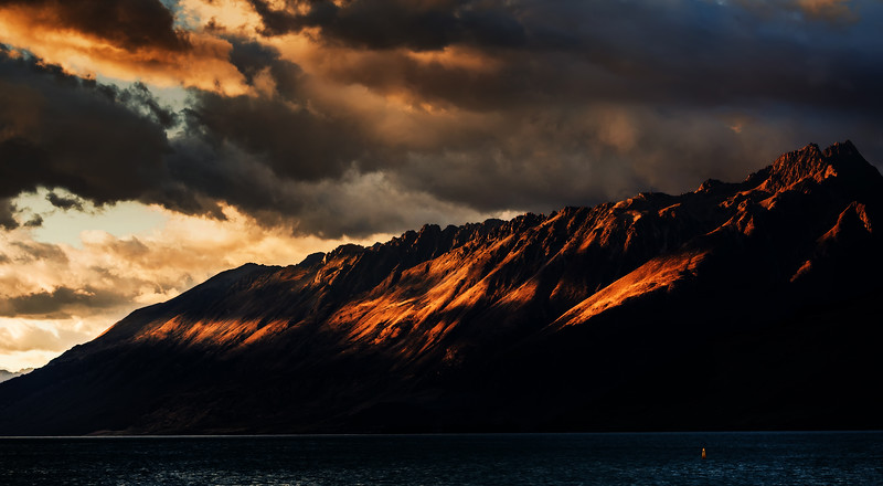 Morning light hits Tooth Peak and Round Peaks above Lake Wakatipu in the Queenstown Lakes District, Otago.