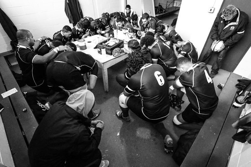 Players showing their religious faith is becoming a more obvious part of the game. Team members of the Old Boys Club in Oamaru say a prayer before a club match against rivals Athletic Marist.