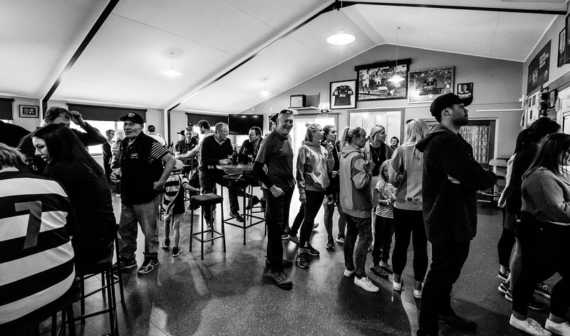 In many parts of New Zealand the local rugby club remains an important social hub like here where patrons line-up at the bar in the Crescent clubrooms following a clash with local rivals Clutha in Kaitangata, 13th April, 2019.
