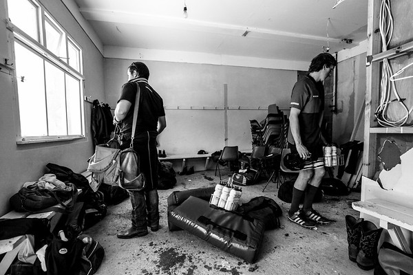 Not all rugby games are played in flash, modern stadiums with all the conveniences. Often, at local, grassroots grounds the changing sheds can be small, tight spaces or even double as storage rooms. Here, just before kick off, the Maniototo side collect the team gear from their changing room at Roxburgh. www.tapebootsandbeer.com