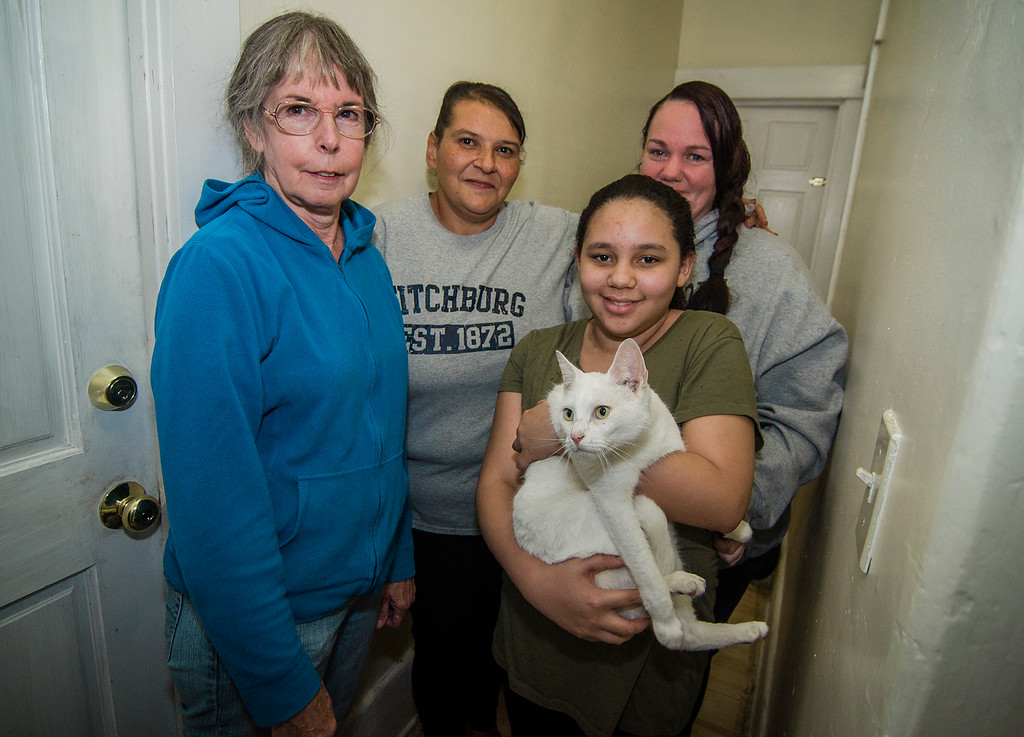 . Fitchburg residents Kathy Goguen and Judy Reardon helped reunite Bella, a cat missing for two years, with her owner Marcia Poland, and daughter Trinity, thanks to a microchip on Tuesday, October 24, 2017. SENTINEL & ENTERPRISE / Ashley Green