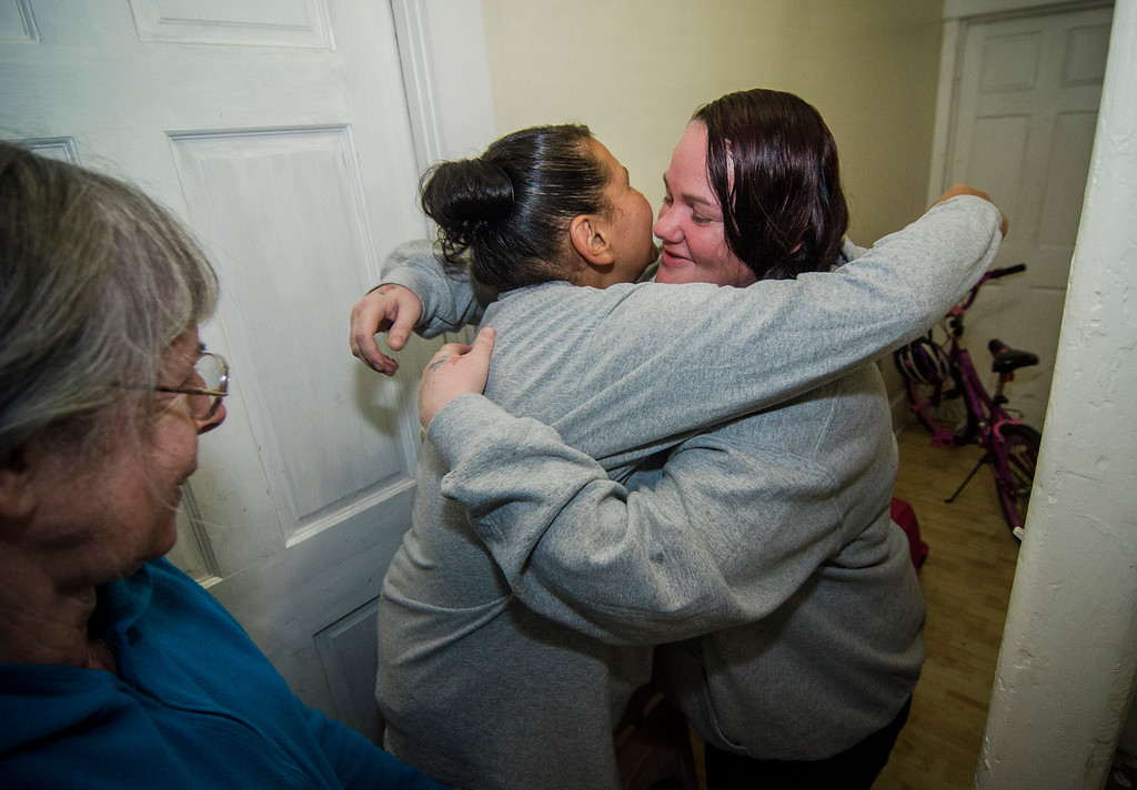 . Fitchburg residents Judy Reardon and Kathy Goguen helped reunite Bella, a cat missing for two years, with her owner Marcia Poland, and daughter Trinity, thanks to a microchip on Tuesday, October 24, 2017. Poland embraces Reardon in thanks on Tuesday evening. SENTINEL & ENTERPRISE / Ashley Green