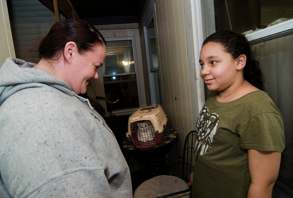 . Fitchburg residents Judy Reardon and Kathy Goguen helped reunite Bella, a cat missing for two years, with her owner Marcia Poland, and daughter Trinity, thanks to a microchip on Tuesday, October 24, 2017. SENTINEL & ENTERPRISE / Ashley Green