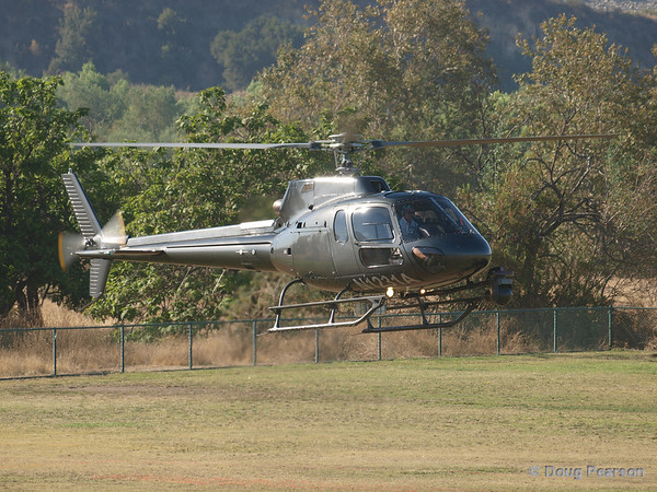 """Landing at Hansen Dam for American Heroes Airshow 2012; N1231A, a Eurocopter AS 350 B2 helicopter known as """"Sky 2"""" for KCBS in LA."""