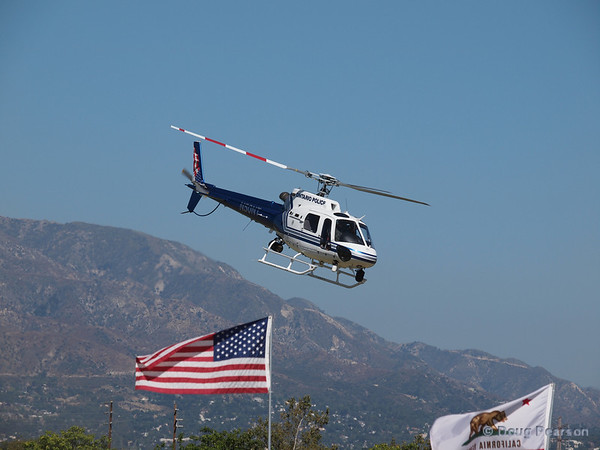 Ontario PD helicopter N50NT leaving Hansen Dam with the flags flying.