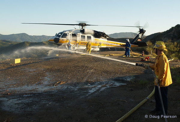 LA County, LA City and Ventura County Helicopters working a Helispot to reload with Water and Fuel.