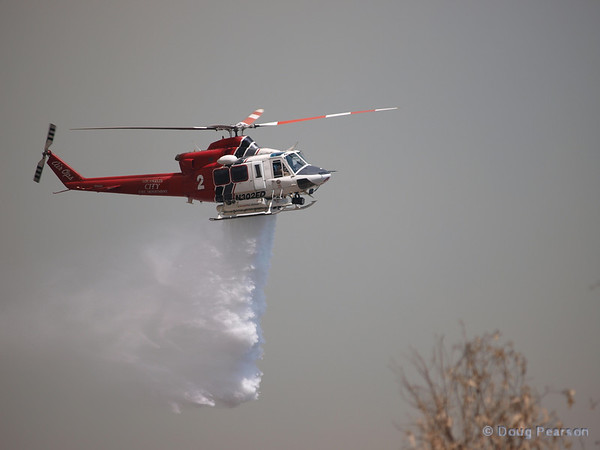 LA City Fire 2 works a Brush fire near Travel Town in Griffith Park, Los Angeles, CA