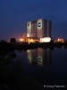 The Vehicle Assembly Building (VAB) is seen here in the early morning with a reflection in the turning basin.