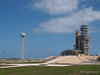 The external fuel tank, solid rocket booster and the nose of space shuttle Endeavour are seen on launch pad 39 A at KSC. The 300,000 gallon water tank is also visible in this shot.