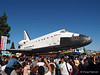 With crowds lining the streets, Endeavour makes her way through the streets of Los Angeles