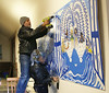 HOLLY PELCZYNSKI - BENNINGTON BANNER Matthew Perry and Vermont Arts Exchange artist and teacher Rhonda Ratray install a mural created by Ratray with a collaboration with students from the Vermont School for girls on Friday morning at Catamount Connections.