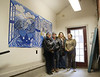 HOLLY PELCZYNSKI - BENNINGTON BANNER  Members of Catamount Connections and The Vermont Arts Exchange pose in front of a mural created by Vermont Arts Exchange artist and teacher Rhonda Ratray along side with students from the Vermont School for girls. From Left to Right Rhonda Ratray, Matthew Perry, Katrina Hastings, and Kayla Becker.