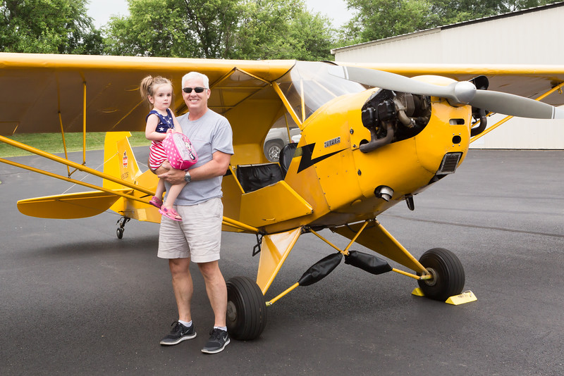 Cate gets her picture taken with Grandpa after the flight.
