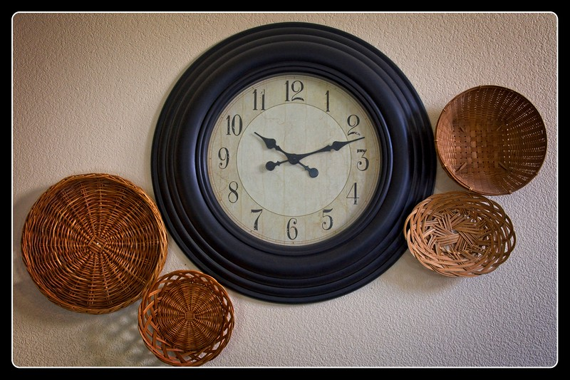 Shaylie's baskets and clock wall art