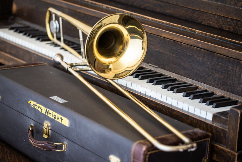 In honor of my Father-in-law, a music teacher. This is his trombone. And the piano in the background is the one that was in my home when I was a kid; it's the piano that both of my sons learned to play on.