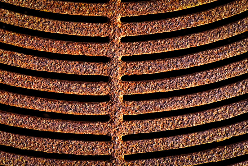 Another rusty grate basking in the sun.