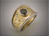 Platinum and 18K yellow gold band with bezel set black diamond and burnish set smaller white diamonds in sandblast finish, by Ron Litolff