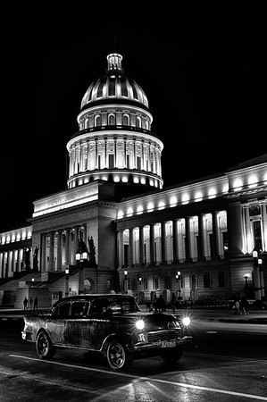 Car driving by Capitol B&W