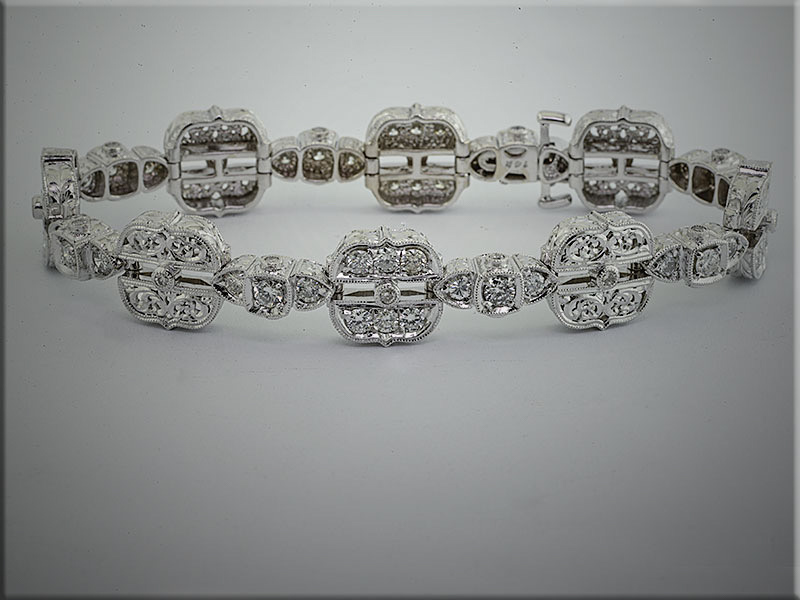 14K white gold exquisite custom diamond bracelet.  Designed and made by Tim Frank