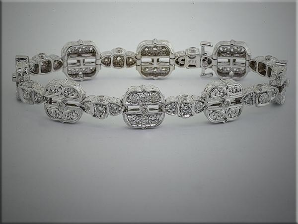 14K white gold exquisite custom diamond bracelet.  Designed and made by Tim Frank