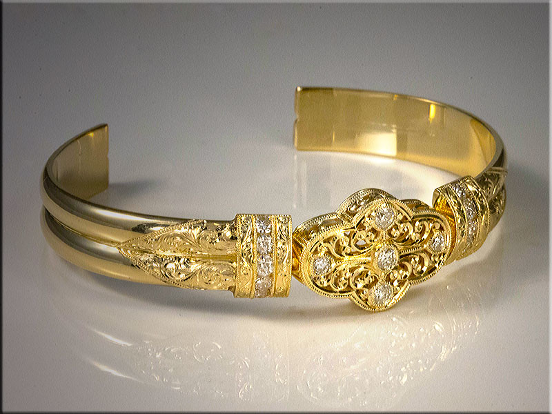 Exquisite custom bracelet in 18K yellow gold using customers diamonds. Designed, made and hand engraved by Tim Frank
