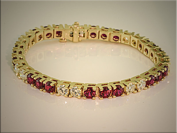 Spectacular ideal cut diamond and Gem quality Burmese rubies in 14K yellow gold bracelet mounting, by Ron Litolff