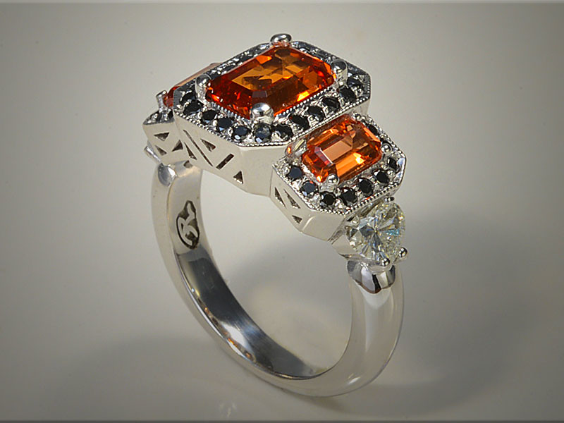 14K White Gold Engagement Ring, Set with Orange Corundum and Black Diamonds.  Designed and made by Ron Litolff.