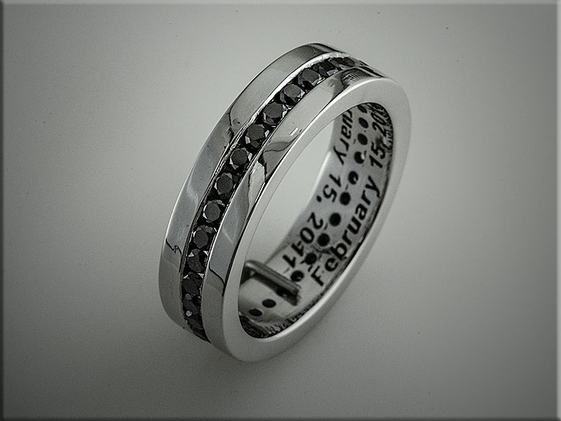 14K white gold custom band with channel set black diamonds around band.  Made by Ron Litolff