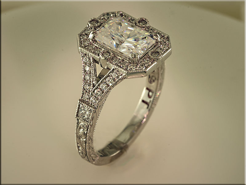 Platinum vintage engagement ring with multiple ideal cut diamonds by Ron Litolff