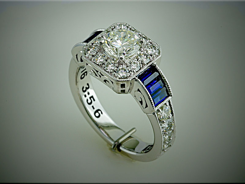 14K white gold remount of customers diamonds, with baguette shaped sapphires on each side. Designed and made by Ron Litolff
