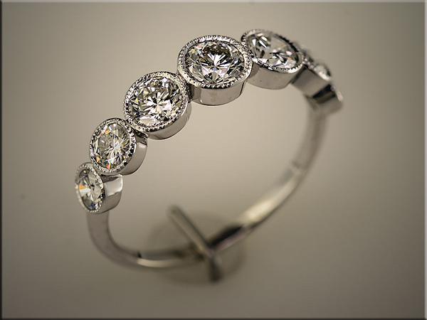 14K white gold bezel set diamond band using customers diamonds Designed and made by Tim Frank