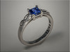14K White Gold Ladys Princess Cut Sapphire Engagement Ring with Infinity Symbols on each side.  Designed and made by Ron Litolff.